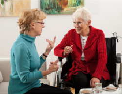 a lady and an old woman talking to each other